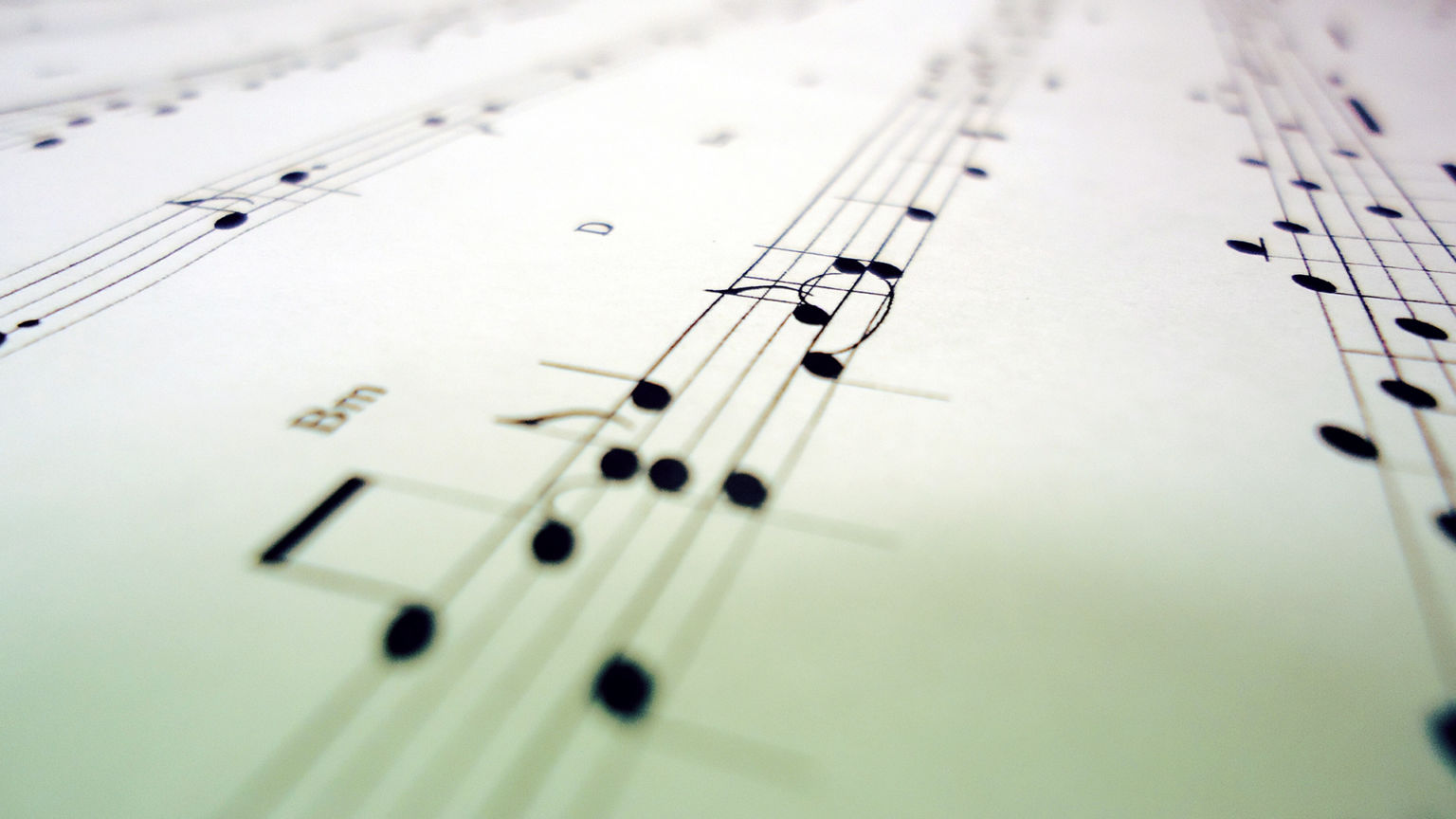 Black and white music notes on a light background