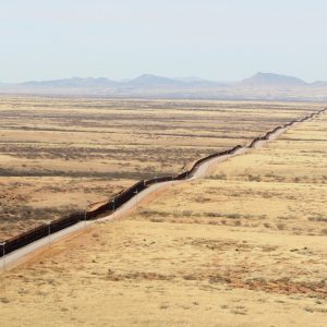 The border wall carves a line in the land between the US and Mexico
