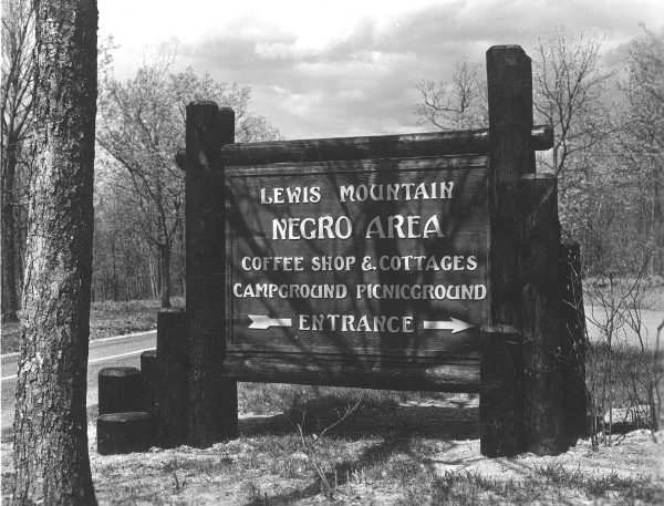 A large wood sign outside of Lewis Mountain, a segregated campground at Shenandoah National Park.