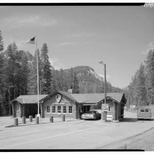 Historic National Park Service log building with American flag