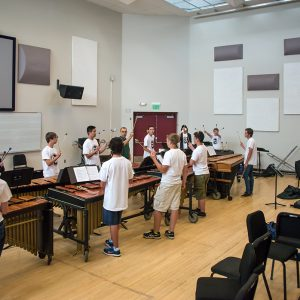 Percussion professor Eric Hollenbeck shows students how to hold mallets