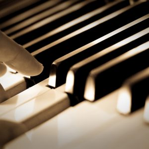 Close up of piano keys being played