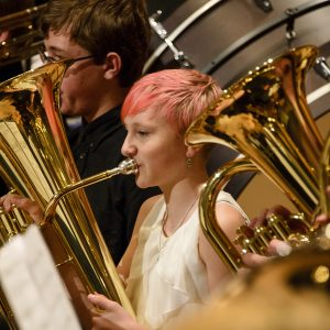 A female middle school euphonium player pictured