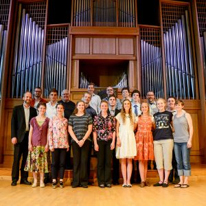 students stand by the organ