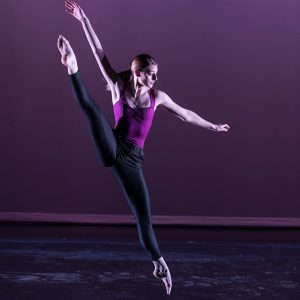 Female dance student leaping