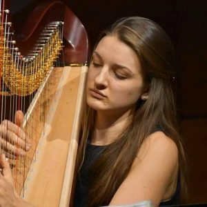 Student pictured playing the Harp