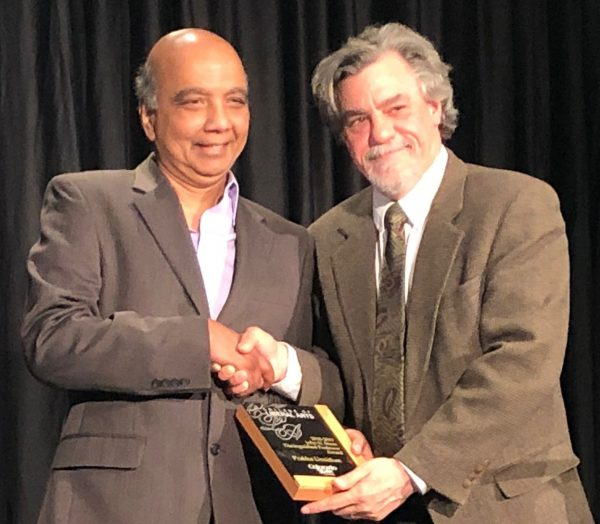 Dr. Unnithan receiving award