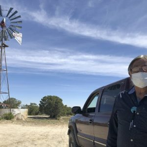 Johnnie Henry, president of the Navajo Nation's Church Rock chapter house community center, hauls drinking water to neighbors in Gallup, N.M.