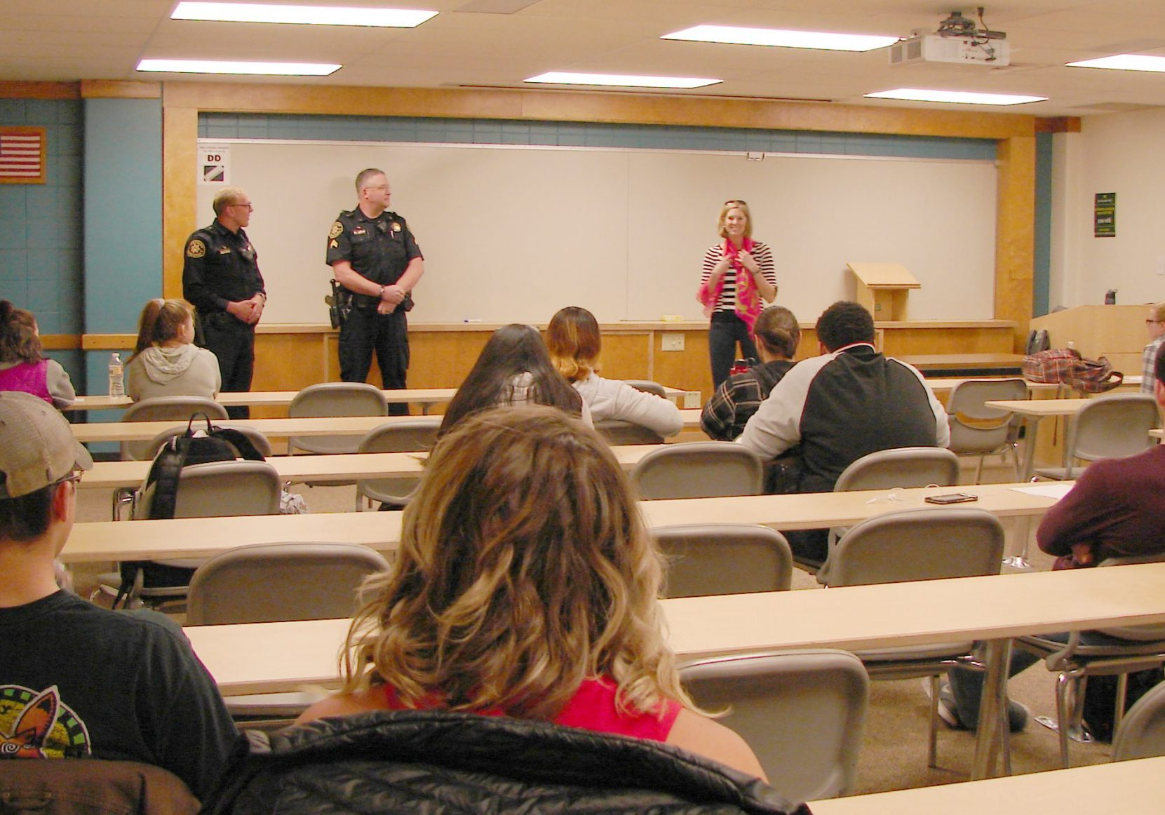 Two police officers present to a class about internship opportunities