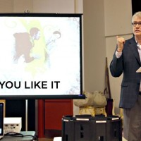 """Kent Thompson introduces his concept for """"As You Like It"""" to the cast at opening rehearsal. Photo by John Moore"""