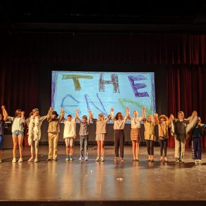 A group of kids take a bow at the end of their performance during Kids Do It All summer music-theatre camp at CSU