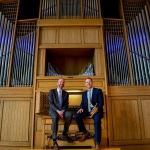 Joel Bacon and Caleb Hudson in front of the Casavant Organ at CSU