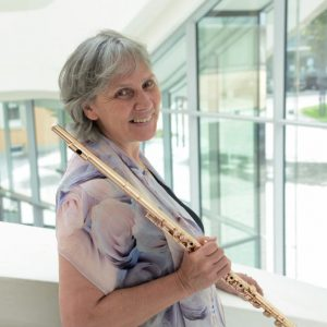 Headshot of Eva Amsler with a flute