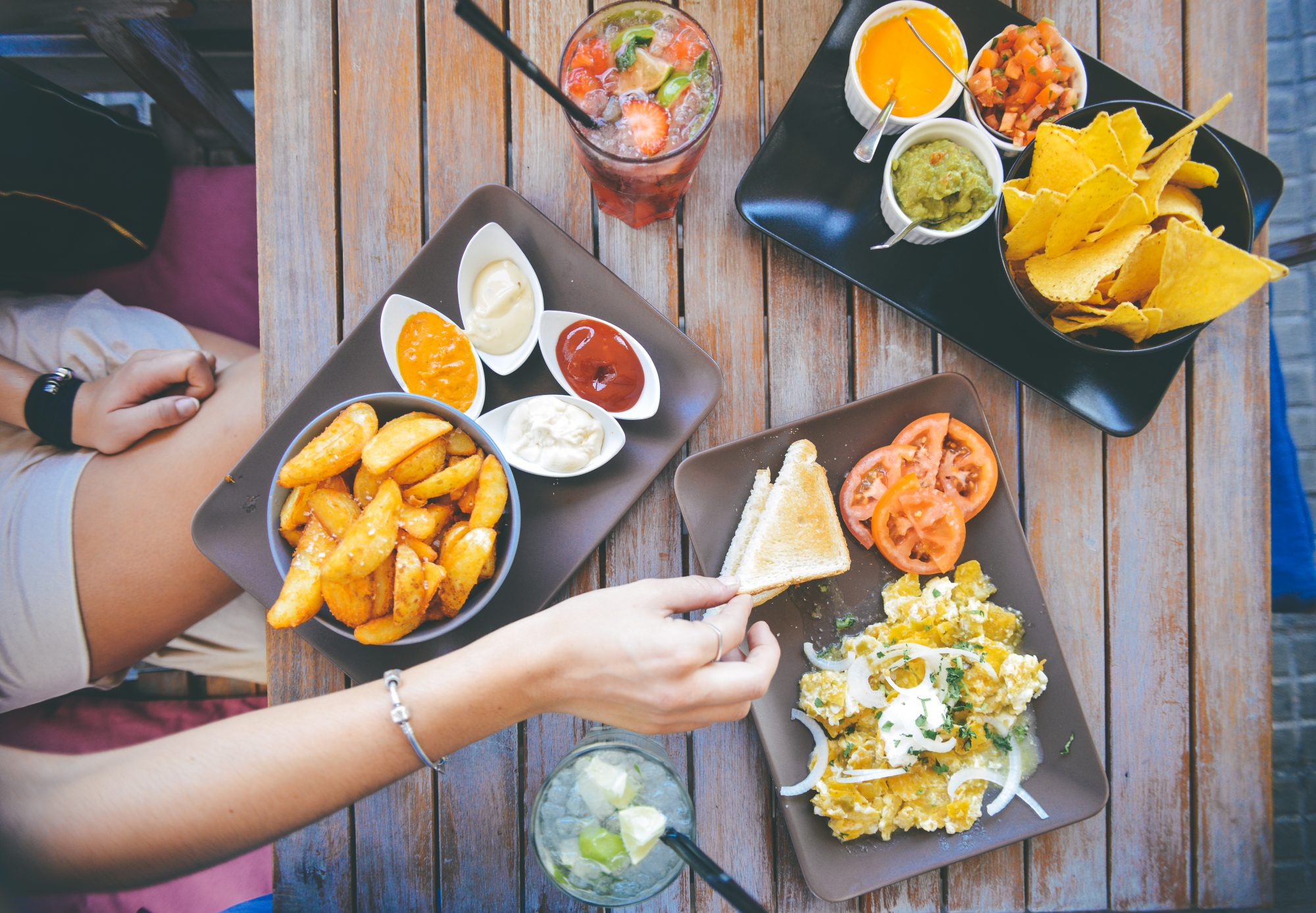 Woman dips chip during dinner at a restaurant