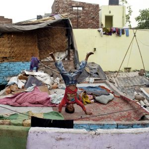 Boy on roof in developing country