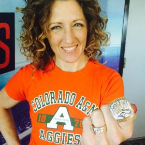 Susie Wargin holding Broncos Superbowl ring