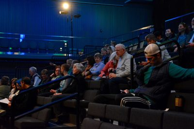 """A group of people wait for the film """"No Land's Song"""" to start as a part of the ACT Human Rights Film Festival, the first of its kind in Colorado. (Photo by Megan Fischer)."""