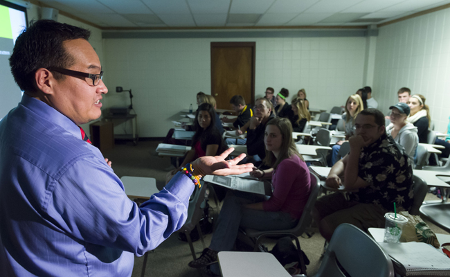 Eric Aoki, Associate Professor of Communication Studies and a 2012 Best Teacher winner, teaches SPCM 434-Intercultural Communication. March 6, 2012
