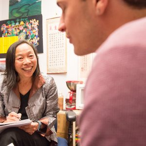 Colorado State University Foreign Languages and Literatures instructor Chuchang Chiu helps students practice their Chinese speaking skills, March 22, 2016.