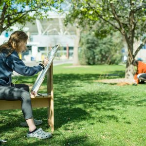 Art student sketching outside the Visual Arts Building