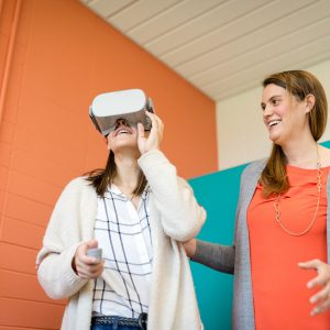Communication studies professor Meara Faw works with virtual reality in her research