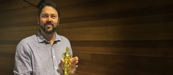 Jeff Werner holds his company's Oscar rewarded for Best Visual Effects for its work on The Jungle Book.