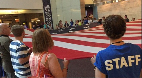 Fuhrman participates in flag folding with museum guests.