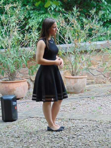 Angela Lamar singing at an outside opera performance.
