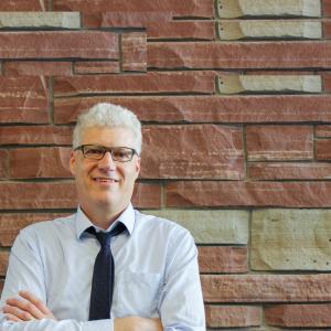 Dr. Greg Dickinson