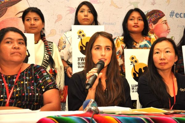 Juliana Vélez speaking at conference in Guatemala