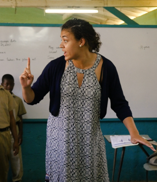 Myanne Hamm voltuneering in Jamaica, teaching local kids the game of hopstotch