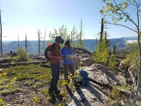 Two students participating in anthropology field school