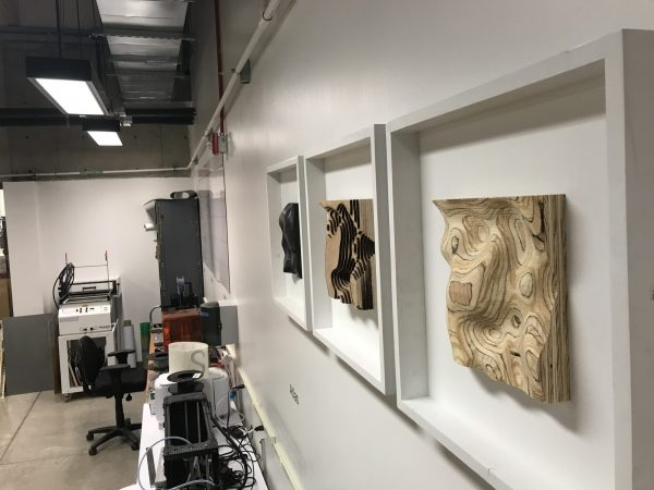 Artwork created from the tools in the Digital Fabrication Lab adorn the walls of the lab
