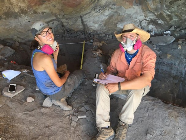 Two students smiling while working at the Skull Creek excavation site