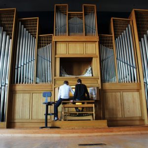 Faculty sits with a student at CSU's Organ