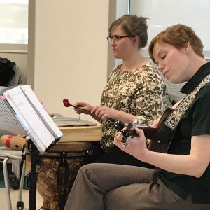 Students play music as part of Moving Through Parkinson's music therapy program