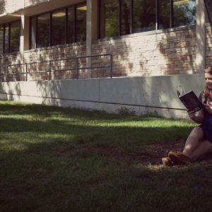 Sitting under tree reading a book