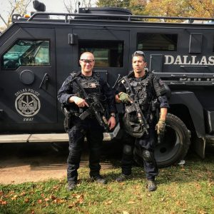 Danny Canete in front of Dallas SWAT vehicle