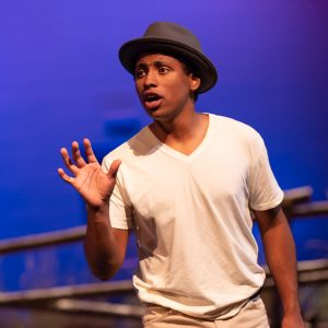 Student performing in fall play, The Laramie Project