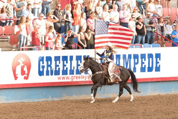 Rodeo horse riding with the American Flag