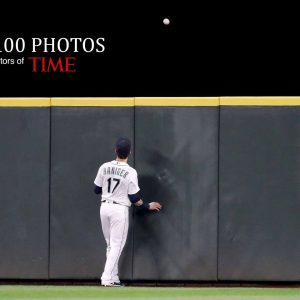 Mitch Haniger of the Seattle Mariners watches a home run by Chad Pinder of the Oakland Athletics in the second inning of a game at Safeco Field in Seattle on Sept. 26. Abbie Parr - Getty Images