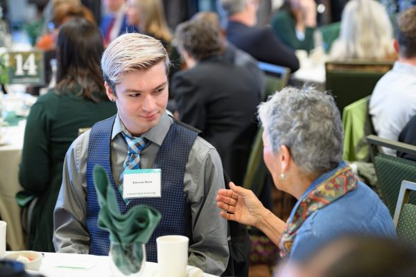 A student talks with a donor