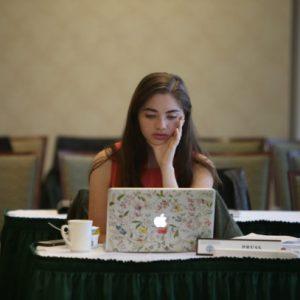 Erin working on her laptop