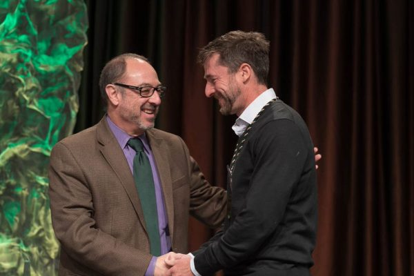 Dan Beachy-Quick shaking hands with Rick Miranda