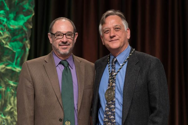 Edward B. Barbier, right, is recognized as a University Distinguished Professor by Rick Miranda at the Celebrate! Colorado State Awards ceremony.