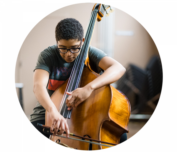 Student practicing the cello at the University Center for the Arts