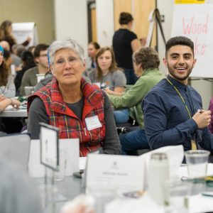 Student with the Center for Public Deliberation holds a community forum on local air quality