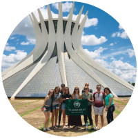 Students holding a Rams Abroad flag during the Global Environmental Politics in Brazil trip