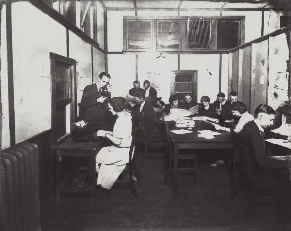 Students working at The Collegian in 1922