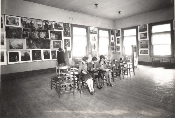 Students attending an art exhibit in 1927